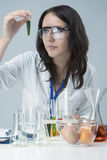 Female Laboratory Staff Dealing with Color Chemicals in Laboratory Stock Photo