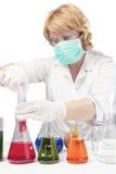 Female laboratory staff dealing with test syringe Royalty Free Stock Photos