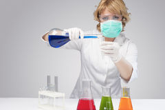 Female laboratory staff dealing with test tube Stock Photos