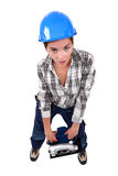 Female laborer carrying sander Royalty Free Stock Image
