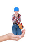 Laborer crouching in a hand. Female laborer crouching in a hand Royalty Free Stock Photos