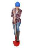 Female laborer digging with shovel Royalty Free Stock Photos