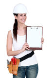 Female labourer with clipboard Royalty Free Stock Photo