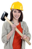 Female labouror holding  hammer Royalty Free Stock Photo