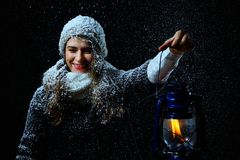 Female with lamp in winter night royalty free stock photography