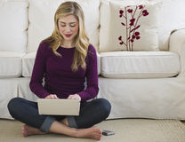 Female on laptop computer in living room Royalty Free Stock Photo