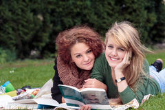Female late teens learn together Stock Photos