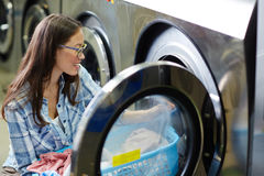 Female in laundry Stock Image