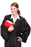 Female lawyer. Full isolated studio picture from a young judge (lawyer) with statute book Royalty Free Stock Images
