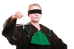 Female lawyer attorney in classic polish black green gown and scales Royalty Free Stock Images