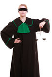 Female lawyer attorney in classic polish black green gown and scales Stock Photos