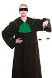 Female lawyer attorney in classic polish black green gown and scales Royalty Free Stock Image