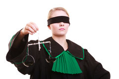 Female lawyer attorney in classic polish black green gown and scales Stock Photo