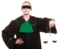 Female lawyer attorney in classic polish black green gown and scales Stock Image