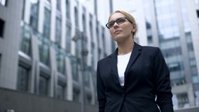 Female lawyer confidently walking out of court, gender and racial equality. Stock photo royalty free stock photo