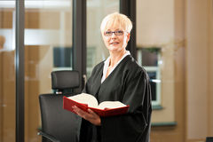 Female lawyer with German civil code. Female lawyer with German civil law code in a court room stock photography