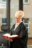 Female lawyer with German civil code. Female lawyer with German civil law code in a court room stock photos
