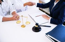 Female lawyer handshake with client. Business partnership meeti. Ng successful concept Royalty Free Stock Images