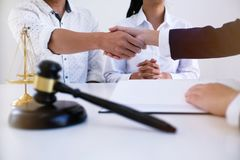 Female lawyer handshake with client. Business partnership meeti stock images