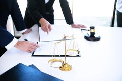 Female lawyer Legal counsel presents to the client a signed cont. Ract with gavel and legal law. justice and lawyer woman business concept stock photos
