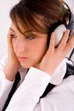 Female lawyer listening music in headset Royalty Free Stock Image