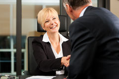 Female Lawyer or notary in her office. Mature female lawyer or notary with client in her office - handshake stock photo