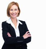 Female lawyer standing with hands folded Stock Photo