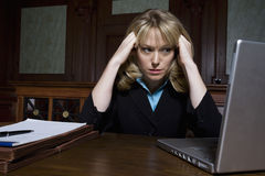 Female Lawyer Using Laptop In Courtroom Stock Photos