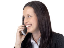 Female lawyer wearing suit and glasses talking on cellphone, looking away Royalty Free Stock Photo