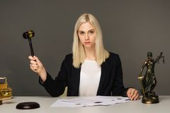 Female lawyer working at table in office. Image royalty free stock photo