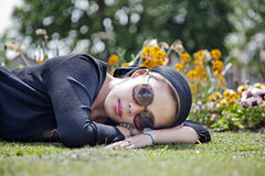 Female laying on the grass Stock Photography