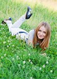 Female laying on grass Stock Photo