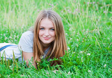 Female laying on grass Royalty Free Stock Image