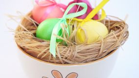 The female lays the egg in a bowl, Easter stock video