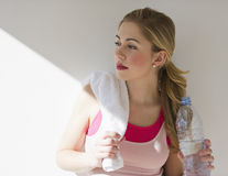 Female leaning against wall in after workout Royalty Free Stock Images