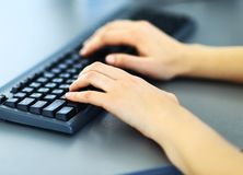 Female learner typing on the keyboard Royalty Free Stock Photography