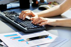 Female learner typing on the keyboard Royalty Free Stock Photo