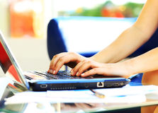 Female learner typing on the laptop keyboard Stock Photo