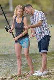 Female learning to fish royalty free stock photography