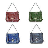 Female leather purse. Purse in four different color executions: red, green, blue and brown Royalty Free Stock Photo