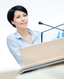 Female lecturer at the podium Stock Photography
