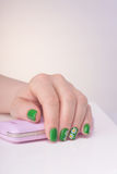 Female left hands with green manicure Royalty Free Stock Image