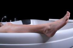 Female leg. Beautiful female leg on the edge of bathtube Royalty Free Stock Photo