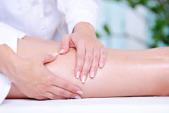 Female leg getting massage by beautician Royalty Free Stock Images