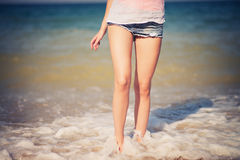 Female leg walking on the beach Stock Image