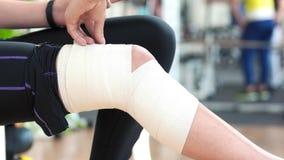 Female leg wrapped with medical bandage. stock footage