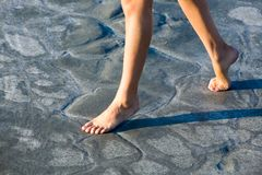 Female legs. Close-up of beautiful female legs walking over ground Stock Photography