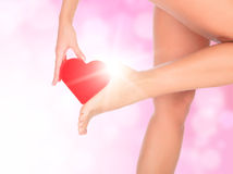 Female legs. Against a pink background with blurred lights Royalty Free Stock Photos