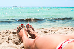 Female legs on beach Stock Photography