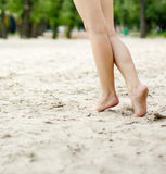 Female legs on a beach background Royalty Free Stock Photography